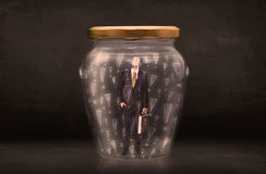 Business man trapped in jar with exclamation marks concept Stock Photography
