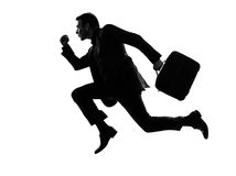 Business man traveler running silhouette Stock Photo