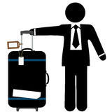 Business Man Traveler & Suitcase with Luggage Tags. A business man traveler with a black suitcase, pull handle up, and copyspace on luggage tags and sticker tape Royalty Free Stock Photography