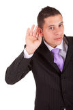 Business man trying to hear Stock Photo