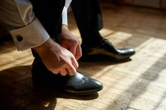 Business man tying shoe laces on the floor Stock Photo
