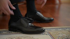 Business man tying shoe laces on the floor. Close-up. stock video