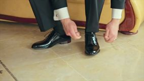 Business Man Tying Shoe Laces on the Floor Groom stock footage