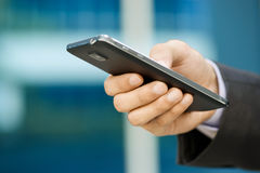 Business Man Typing With Finger On Phablet Smartphone Stock Photography