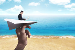 Business man typing with laptop on the paper plane Stock Images
