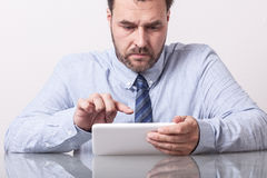 Business man, typing on tablet computer. Mature C Stock Photo