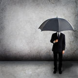 Business man with umbrella. Business man holding an umbrella Royalty Free Stock Images