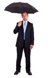 Business man with umbrella Stock Photos