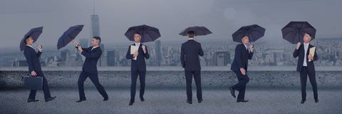 Business man with umbrella collage against city background. Digital composite of Business man with umbrella collage against city background Royalty Free Stock Photography