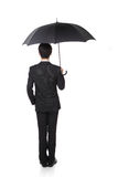 Business Man with an umbrella. Concept for business and insurance, isolated against white background, asian male model Stock Photos