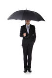 Business Man with an umbrella. Concept for business insurance and save money, full length, isolated against white background, asian male model stock photography
