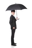 Business Man with an umbrella. Concept for business insurance and save money, full length, isolated against white background, asian male model Stock Photos