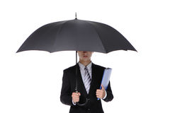 Business Man with an umbrella. Concept for business insurance and save money, isolated against white background, asian male model Royalty Free Stock Photography