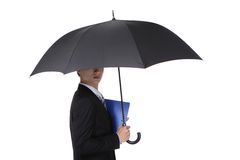 Business Man with an umbrella. Concept for business insurance and save money, isolated against white background, asian male model Royalty Free Stock Image
