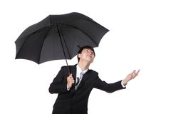 Business Man with an umbrella. Concept for business insurance and save money, isolated against white background, asian male model Stock Images