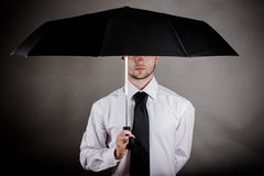 Business man with an umbrella. In hand Stock Images