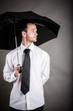 Business man with an umbrella Stock Photos