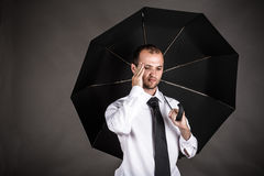 business man with an umbrella headache Stock Photography
