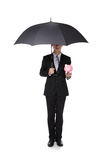 Business Man with an umbrella and piggy bank. Concept for insurance and save money, full length, isolated against white background, asian male model Stock Images