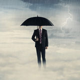 Business man with umbrella standing on the cloud with thunder Royalty Free Stock Photos