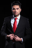Business man unbuttons his jacket Royalty Free Stock Photo