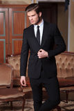 Business man unbuttons suit looking away Stock Photography