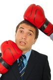 Business man under pressure. Conceptual image of business man between two boxing gloves under pressure isolated on white background Stock Photography