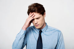 Business man under pressure. Stressed-out businessman with hand on his head Stock Images