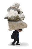 Business man under pressure and stress rocks. Business man under a huge pile of rocks who is feeling the pressure and stress of this big challenge Royalty Free Stock Photography