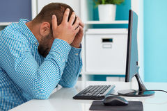 Business man under stress. Young business man under stress with headache Royalty Free Stock Image