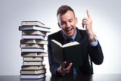 Business man understands his book Royalty Free Stock Image