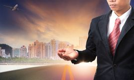 Business man and urban building background Stock Image