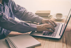 A business man use laptop and smart phone for working his busine Royalty Free Stock Photography