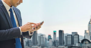 Business man use mobile phone at top of office building see view Stock Images