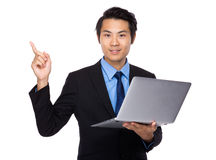 Business man use of notebook and finger point up Stock Photo