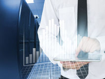 Business man use tablet for analyze in data center Stock Photography