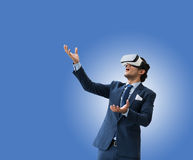 Business man use VR virsual for future business and earn money f Royalty Free Stock Photo