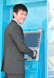Business man using ATM stock images