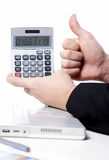 Business man using calculator with thumb up Stock Photography