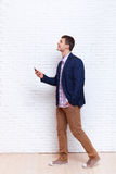 Business Man Using Cell Phone Smartphone Look Up To Copy Space Social Network Communication. Business Man Using Cell Phone Smartphone Going Look Up To Copy Space Royalty Free Stock Photography