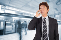 Business man using cellphone Stock Images