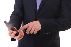 Businessman using cellphone. Royalty Free Stock Images
