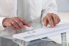 Business man using computer keyboard Stock Photos