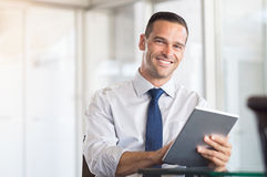 Business man using digital tablet Stock Photography