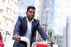 Business man using hire bike Stock Photos