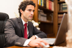 Business man using his laptop Royalty Free Stock Photo