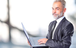 Business man using his laptop Stock Image