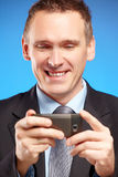 Business man using his mobile phone Royalty Free Stock Photography
