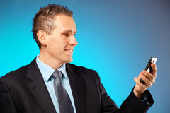 Business man using his mobile phone Stock Photo