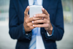 Business man using his mobile phone Stock Photography